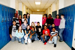 "Bluestone Middle School students participated in the ""Hearts to Heroes"" campaign, an effort sponsored by 3WD radio station and Mecklenburg Electric Cooperative, to remember troops stationed in Kuwait on Valentine's Day. The Cooperative created and printed the giant card that was signed by students who sent their best wishes to the soldiers of Alpha Company 3rd Platoon.  The successful effort resulted in 21 boxes of donated items, weighing a collective 1,100 pounds, contributed by the community and sent to the platoon in Kuwait. Above, Chase City Elementary School students participated in the ""Hearts to Heroes"" campaign by signing a Valentine poster for soldiers in Alpha Company 3rd Platoon."