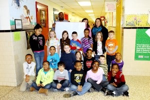 "Above, Chase City Elementary School students participated in the ""Hearts to Heroes"" campaign by signing a Valentine poster for soldiers in Alpha Company 3rd Platoon."