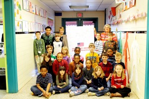 "Students from Clarksville Elementary School signed this giant poster sending Valentine greetings and support to soldiers in Alpha Company 3rd Platoon who are stationed in Kuwait. The ""Hearts to Heroes"" campaign was sponsored by 3WD radio station and Mecklenburg Electric Cooperative."