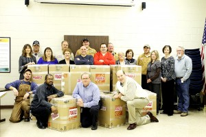 "Employees of Mecklenburg Electric Cooperative (MEC), some of whom are pictured above, and 3WD radio station partnered in the ""Hearts to Heroes"" campaign to send Valentine greetings, snack foods and other items to brighten the day for soldiers in Kuwait. The Cooperative packed and shipped 21 boxes of donations that weighed over 1,100 pounds. 3WD and MEC extend thanks to everyone who donated to this project for our heroes."
