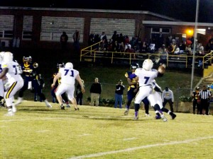 Josh Paynter drops back to pass against Bluestone in the Chargers win last Friday night.